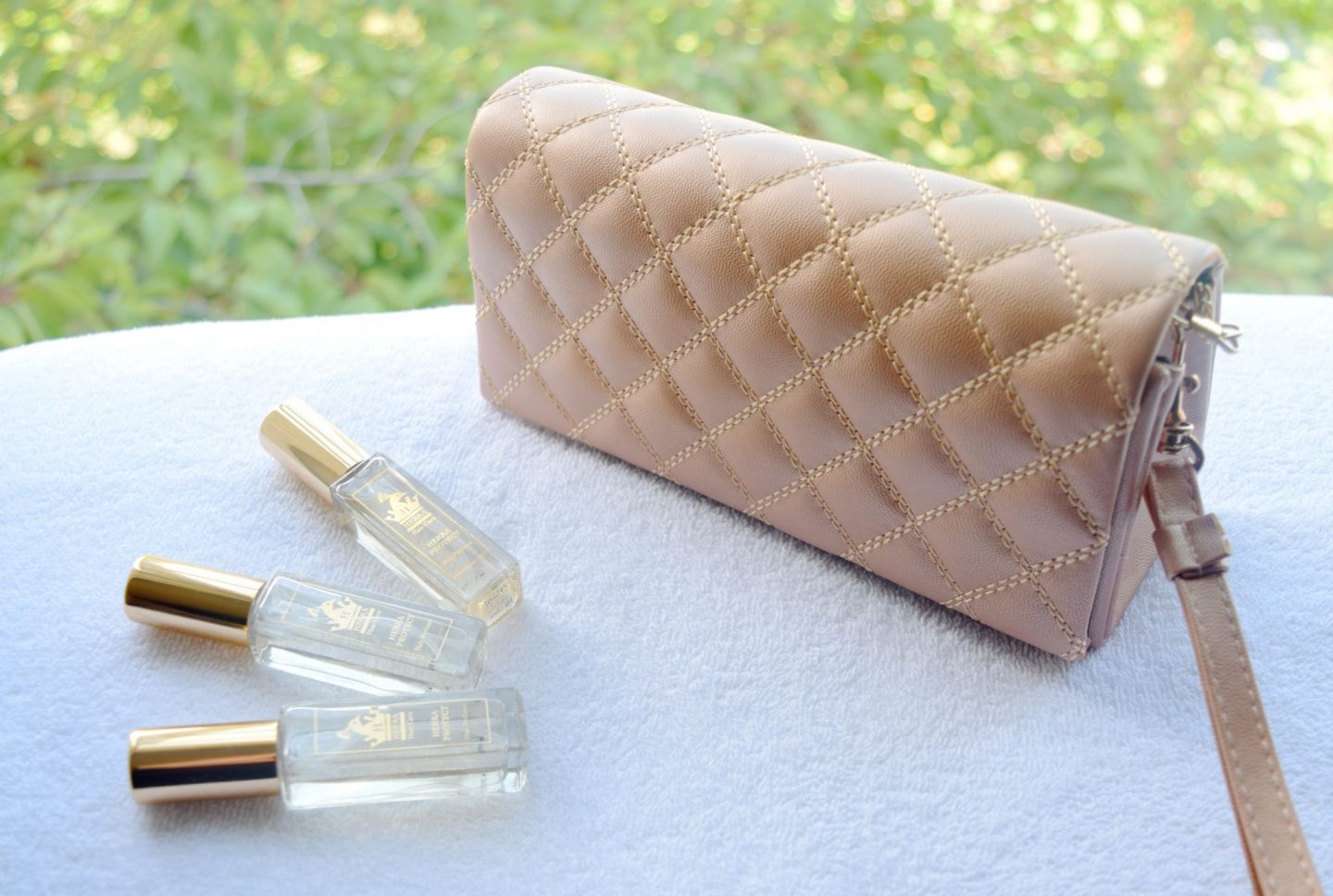 Herra Protecting Hair Perfume Oud Inspired clutch
